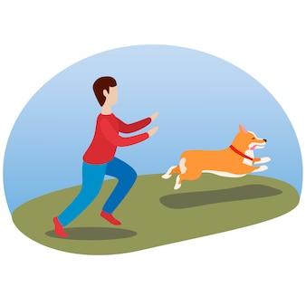Ein mann geht mit seinem hund. glücklicher netter hund. waliser corgi. welpenspaß läuft und streckt seine zunge heraus.