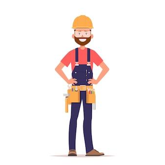 Ein mann in einem bauhelm und arbeitskleidung mit werkzeugen.