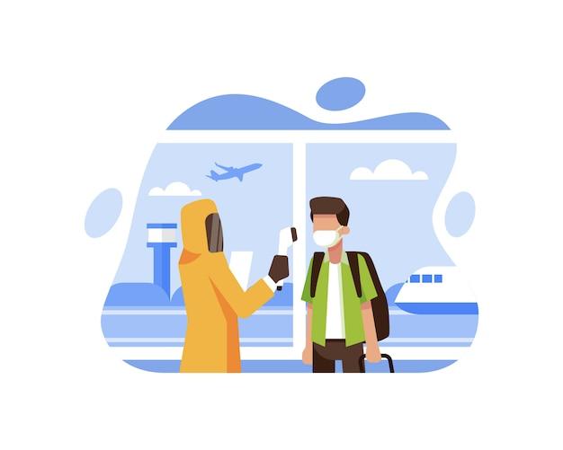 Ein medizinischer mitarbeiter, der persönliche schutzausrüstung trägt, überprüft passagiere, die gerade am flughafen angekommen sind