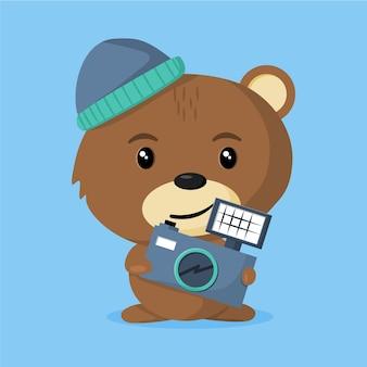 Ein niedlicher bärenarbeiterfotograf mit seiner kamera