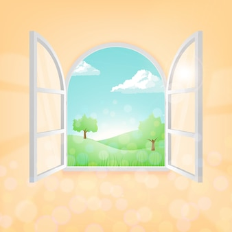 Ein offenes fenster mit einer schönen landschaft bei gutem sonnigem wetter im frühling oder sommer.