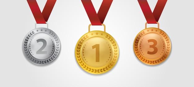 Ein satz von realistischen 3d champion gold silber- und bronzemedaille mit roter bandillustration