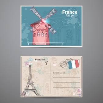 Ein satz von zwei seiten einer postkarte zum thema paris