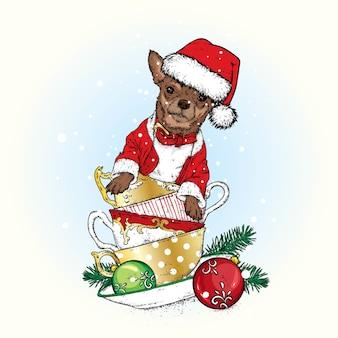 Ein schöner hund in einer weihnachtsmütze sitzt in vintage-bechern