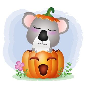 Ein süßer koala im halloween-kürbis