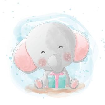 Ein süßes elefantenbaby bekommt ein geschenk