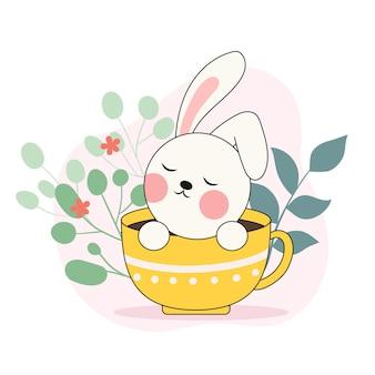 Ein süßes kleines weißes kaninchen in einer tasse