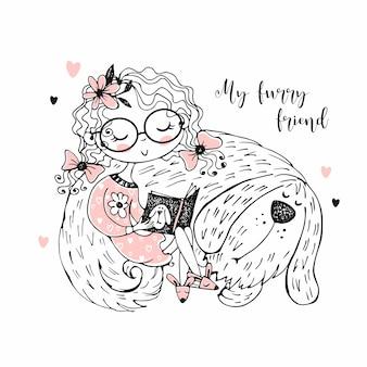 Ein süßes mädchen liest ein buch neben ihrem zotteligen hund.