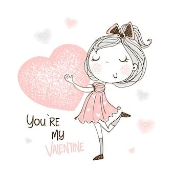 Ein süßes mädchen mit einem großen herzen in den händen. du bist mein valentine.
