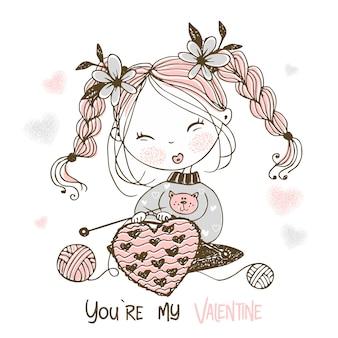 Ein süßes mädchen strickt ein großes herz. du bist mein valentine.