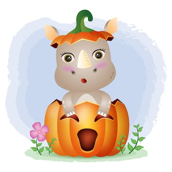 Ein süßes nashorn im halloween-kürbis