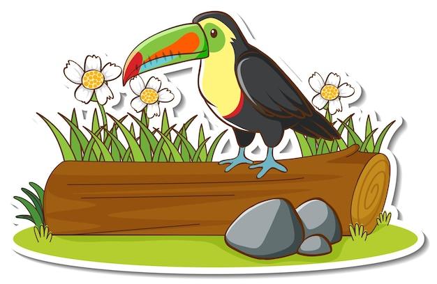 Ein tukanvogel, der auf einem baumstammaufkleber steht