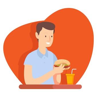 Ein unternehmer ist in einem fast-food-restaurant und isst während der mittagspause einen burger