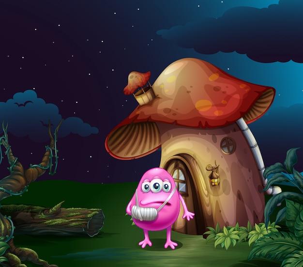 Ein verletztes rosa monster in der nähe des pilzhauses