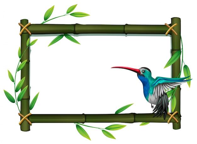 Ein vogel an der bambusgrenze
