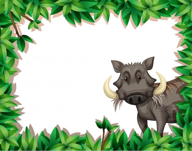 Ein warzenschwein auf naturrahmen