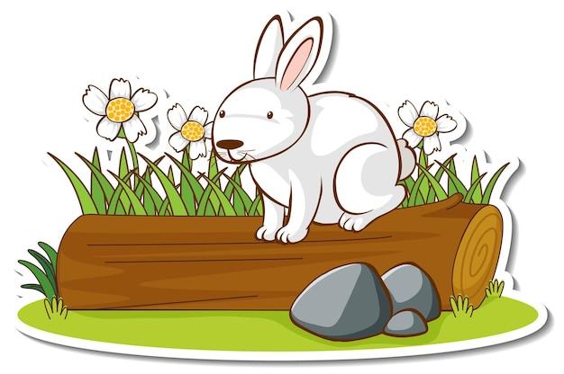 Ein weißes kaninchen, das auf einem baumstammaufkleber steht