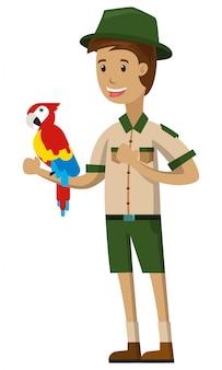 Ein zookeeper, der mit dem vogel lokalisiert auf weißem hintergrund spielt