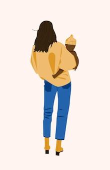 Eine afroamerikanische frau hält ein baby in den armen. eine junge mutter mit einem kind steht mit dem rücken. das konzept der mutterschaft.