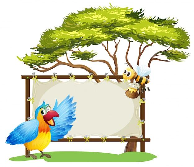 Eine anschlagtafel, ein vogel und eine honigbiene