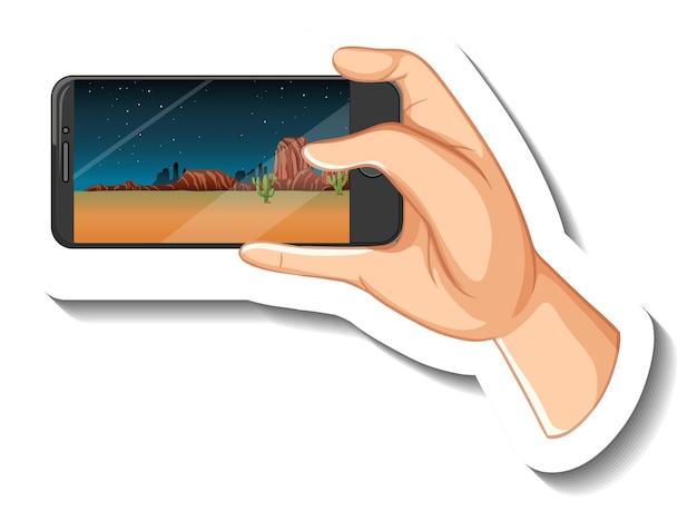 Eine aufklebervorlage mit der hand, die ein smartphone hält