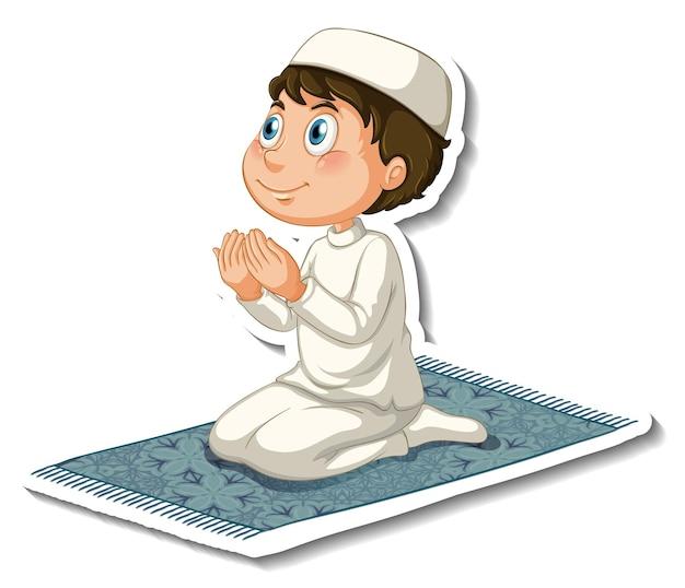 Eine aufklebervorlage mit einem muslimischen jungen, der auf einem teppich sitzt und betet