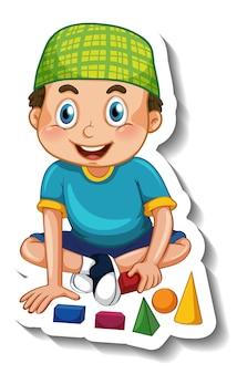 Eine aufklebervorlage mit einem muslimischen jungen, der mit seinen spielsachen spielt