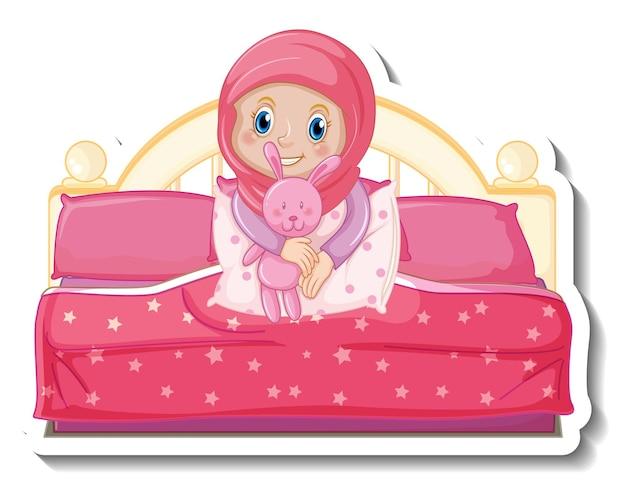 Eine aufklebervorlage mit einem muslimischen mädchen, das auf dem bett sitzt