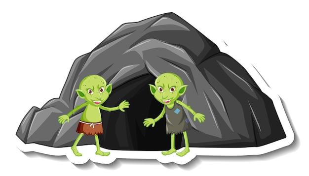 Eine aufklebervorlage mit einer grünen kobold- oder troll-cartoon-figur und einer steinhöhle