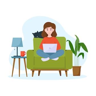 Eine frau arbeitet an einem laptop auf einem sessel work-from-home-konzept freiberuflich