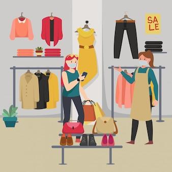 Eine frau, die kleidung in der boutique kauft und dabei abstand zu anderen hält