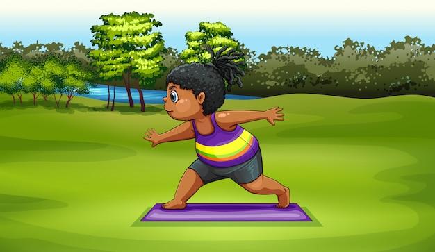 Eine frau, die yoga nahe dem fluss tut