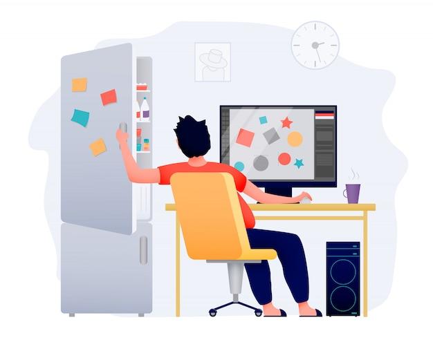 Eine freiberufliche person arbeitet zu hause am computer. ein kühlschrank mit leckerem essen lenkt ab.