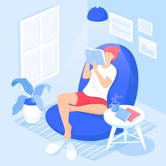 Eine fröhliche frau, die in einem bequemen stuhl sitzt und ein fiction-buch liest. entzückender junger mann, der das wochenende zu hause verbringt. freizeit-, erholungs- und entspannungsaktivitäten.