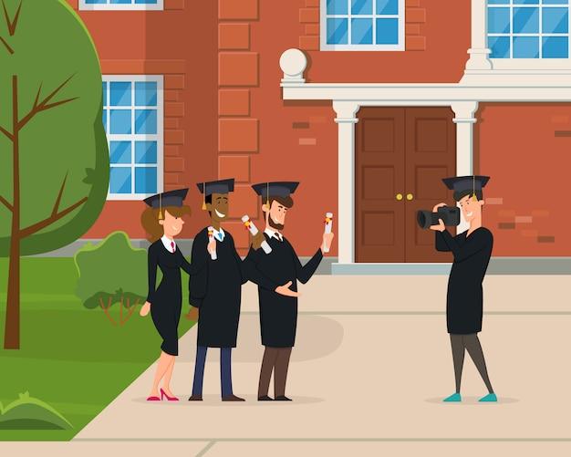 Eine gruppe junger absolventen wird vor dem hintergrund der universität fotografiert