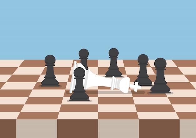 Eine gruppe schwarzer schachfiguren besiegt den weißen könig