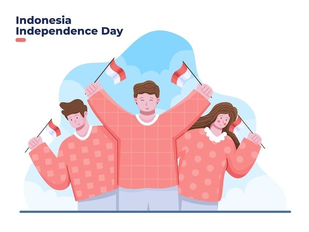 Eine gruppe von menschen feiert den unabhängigkeitstag von indonesien am 17. august mit dem halten der indonesischen nationalflagge