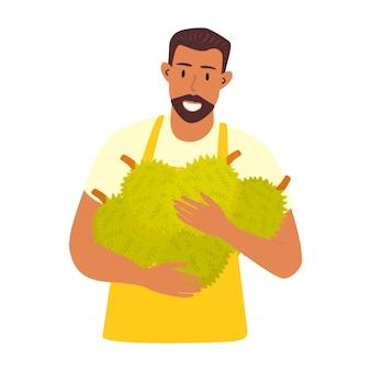 Eine illustration eines männlichen bauern, der durianfrüchte in seinen händen hält Premium Vektoren