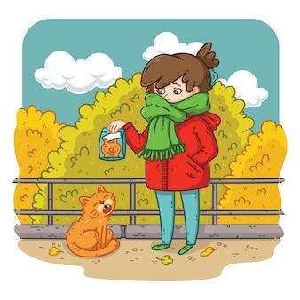 Eine junge frau plant, eine streunende katze zu füttern.