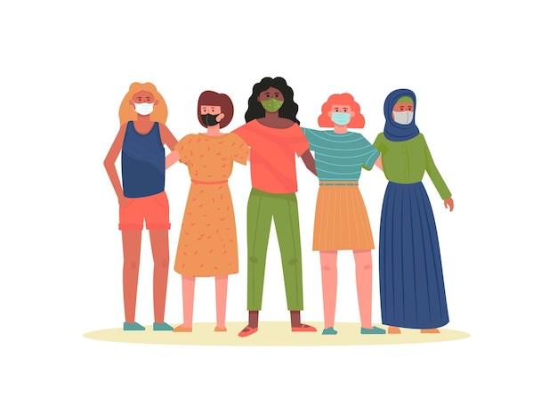 Eine multiethnische gruppe junger hübscher frauen, die gesichtsmasken tragen.
