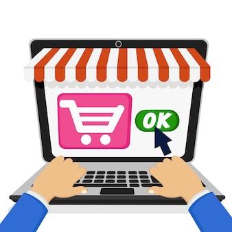 Eine person durch einen laptop macht einen kauf in einem online-shop. auf weißem hintergrund