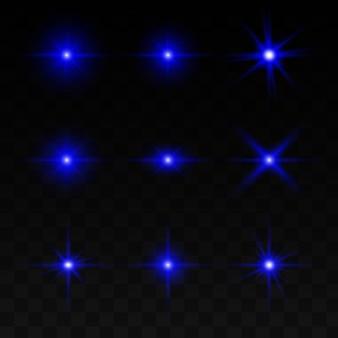 Eine reihe von lichteffekten, lichtern und funken. blaues licht auf einem transparenten hintergrund.