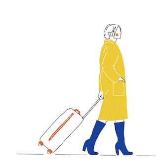 Eine reisende frau, die einen koffer trägt