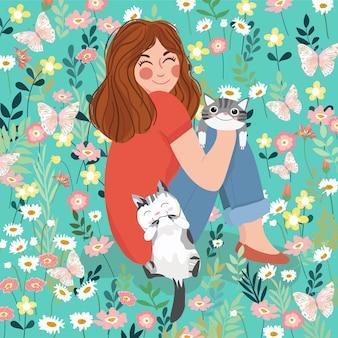 Eine reizende dame mit niedlichem kätzchen glücklich im blumengarten.