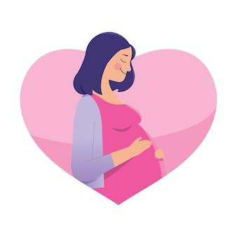 Eine reizende junge schwangere frau, die ihren bauch mit liebe hält
