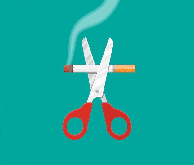 Eine schere schnitt eine zigarette.