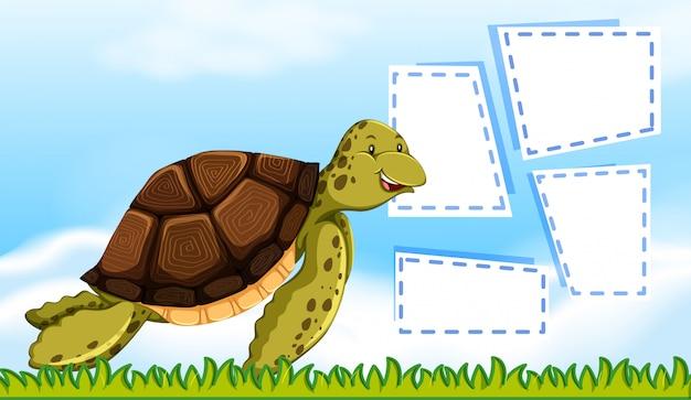 Eine schildkröte auf leeren anmerkungsrahmen