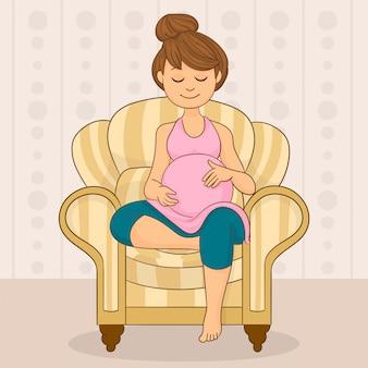Eine schwangere frau, die auf dem sofa sitzt