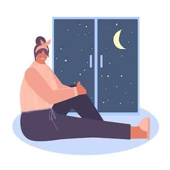 Eine traurige, einsame frau sitzt am fenster. das konzept der depression.