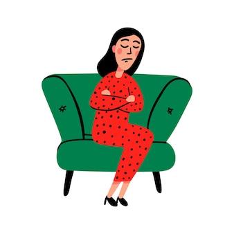 Eine traurige junge frau auf dem sofa Premium Vektoren